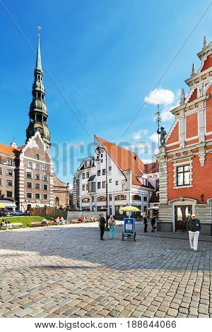 City Hall Square With People And St Peter Church Riga