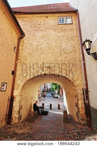 Archway And People In Historical Center Of Old Town Riga