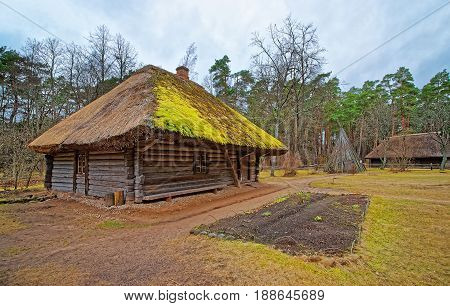 Old Wooden House In Ethnographic Open Air Village Riga