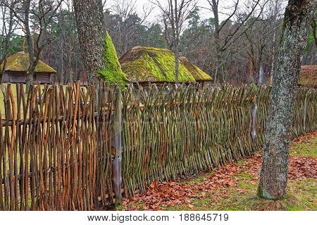 Old House And Wooden Fence In Ethnographic Village In Riga