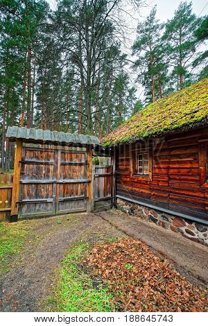 Old House And Wooden Fence At Ethnographic Village In Riga
