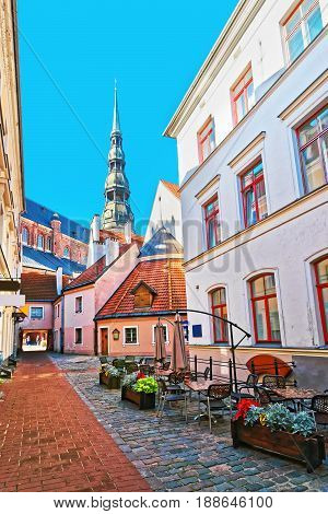 Street Cafe And Spire Of St Peter Church Riga