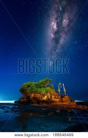 Milky way over Tanah Lot Temple at night in Bali Indonesia.(Dark)