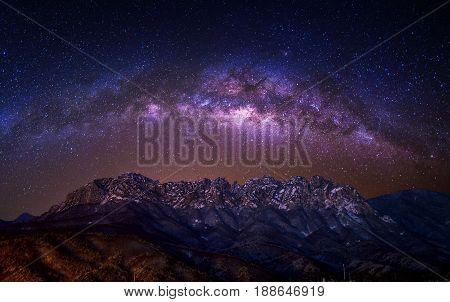Ulsan bawi Rock with Milky way galaxy on Seoraksan mountains in winter South Korea.