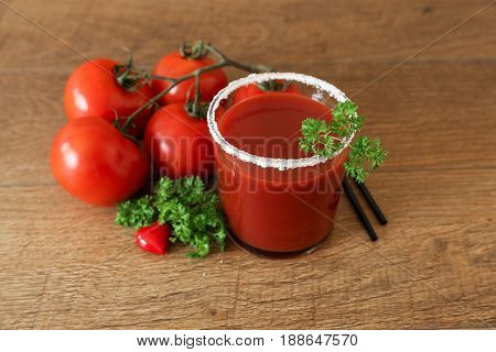 Tomato Juice, Tomatoes, Parsley And Ceramic Heart On A Wooden Background.