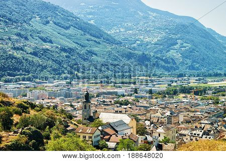 Sion Cityscape With Valley And Bernese Alps Mountains Valais Switzerland