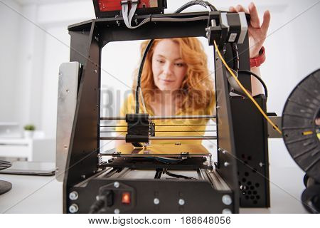 While working. Selective focus of a modern 3d printing machine while doing the printing of 3d object