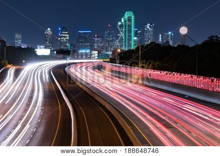 Dallas Texas city skyline at Night with traffic light trails