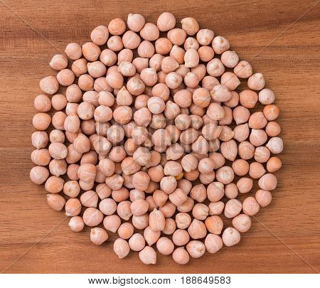 Circle Heap Of Chick Peas, Chickpeas On A Dark Board. Top View, Close-up.