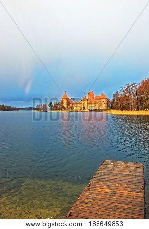 Trakai Island Castle Museum And Rainbow At Galve Lake
