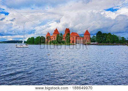People At Sailing Boats On Galve Lake Trakai Island Castle