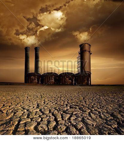 Global Warming and pollution theme with chimneys;gas and dry land