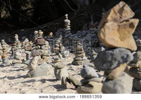 a lot oft Stone Cairns on a Beach, Blur effects