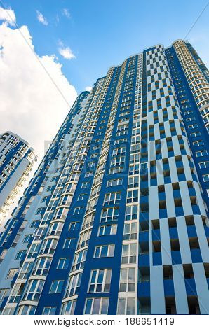 Facade of a tall residential building. High-rise buildings modern architecture skyline.