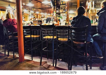 People Sitting At Bar Counter In Boston