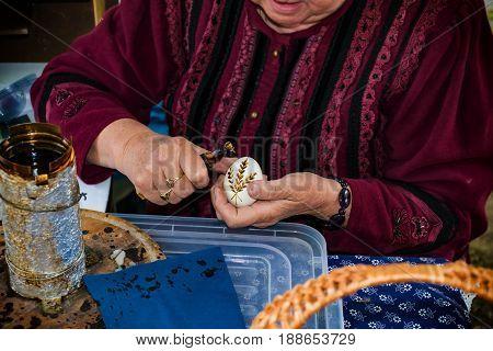 Woman In Folk Costume Paints Traditional Easter Egg  - Folk Art