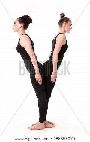 The letter Y formed by Gymnast bodies on white studio background