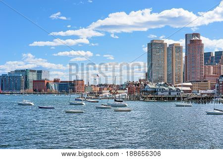 Floating Boats With The Skyline Of Boston Ma