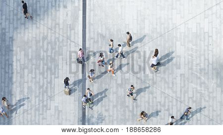 people walk on across the pedestrian concrete landscape (wide angle of aerial top view)