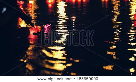 Floating lighting water Lanterns on river at night, telephoto