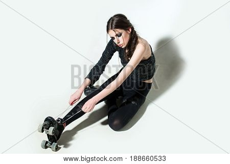 Sexy Girl On Rollers With Fashionable Makeup, Long Brunette Hair