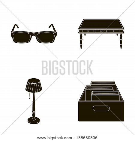 Glasses, a wooden table, a floor lamp, a box with books. A library and a bookstore set collection icons in black style vector symbol stock illustration .