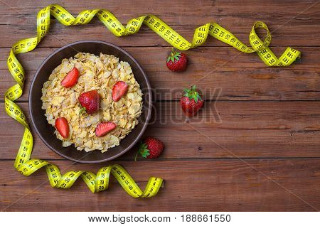 Dietary Food: Corn Flakes And Strawberries On A Wooden Table Top View.