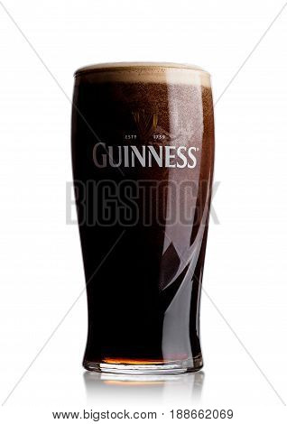 London, Uk - May 29, 2017: Cold Glass Of Guinness Original Beer On White. Guinness Beer Has Been Pro