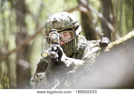 Photo of snipers with airsoft automatic rifle with telescopic sight in forest