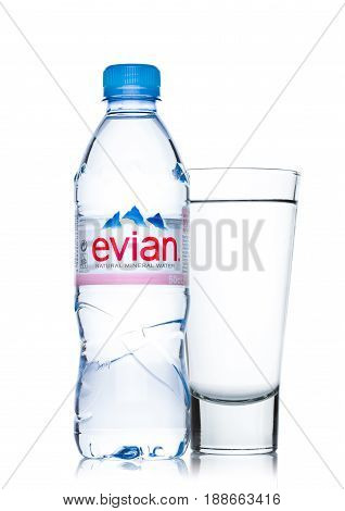 London, Uk - May 29, 2017: Bottle Of Evian Natural Mineral Water With Glass On A White. Made In Fran