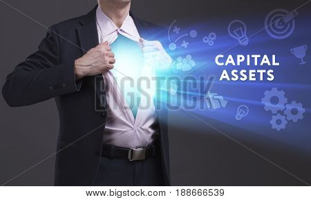 Business, Technology, Internet And Network Concept. Young Businessman Shows The Word: Capital Assets