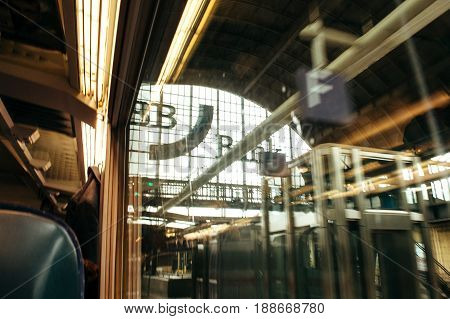 KARLSRUHE GERMANY - JUL 29 2015: View from the train window of the train station and the BB Bank inscription on the facade at the exit from the train station