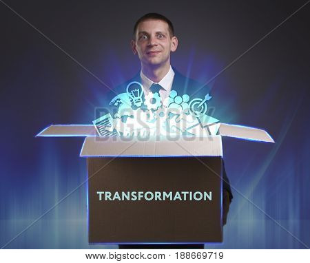 Business, Technology, Internet And Network Concept. Young Businessman Shows The Word: Transformation