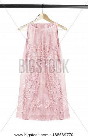 Sleeveless mini pink linen dress on wooden clothes rack isolated over white