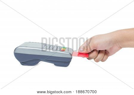 Hand holding credit card swipe through terminal for sale isolated on white background