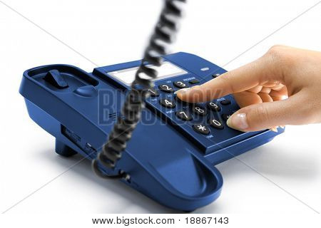 One hand pressing key on blue phone