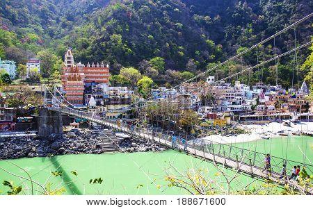 RISHIKESH, INDIA - April 03, 2014 - The main view to Ganga river, bridge and temple