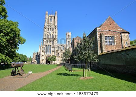View of The West front of the Cathedral from a public garden with a gun in the foreground in Ely, Cambridgeshire, Norfolk, UK