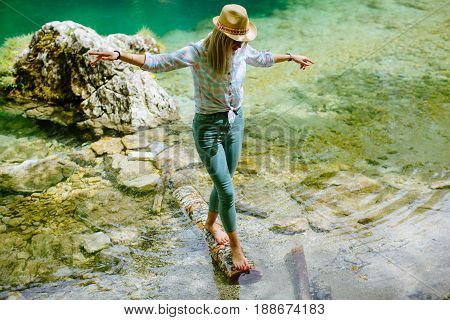 Woman Balancing On Wood Log