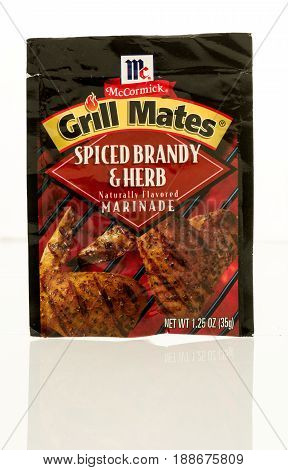 Winneconne WI - 16 May 2017: A pouch of McCormick grill mates spiced brandy and herb marinade an isolated background