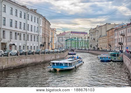 SAINT - PETERSBURG, RUSSIA - MAY 24, 2017: People in excursion boat sail on The Moika River in the center of the city
