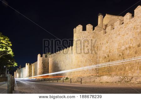 Walls Of The Historic City Of Avila At Night With A Car Light Trail, Castilla Y Leon, Spain