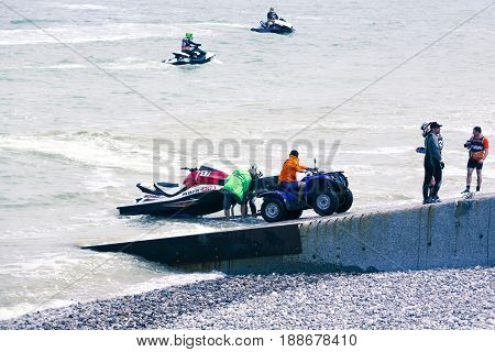 Veulette sur mer Normandy France - May 28 2017. Unidentified competitors are going to the sea to be ready for the competition championship France.