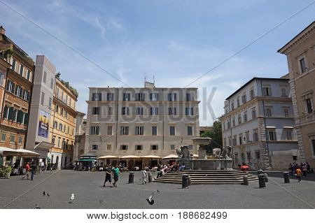ROME ITALY - MAY 23 2017: local life at Santa Maria in Trastevere square the fountain of Roman origin was restored by Carlo Fontana in 1692