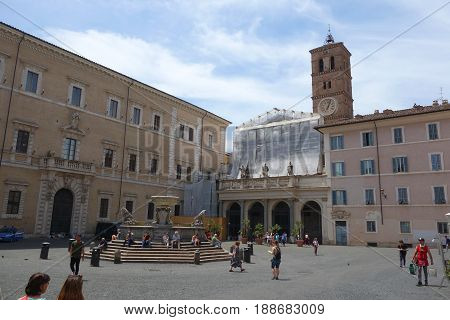 ROME ITALY - MAY 24 2017: local life at Santa Maria in Trastevere square the fountain placed at the centre of the square is of Roman origin and was restored by Carlo Fontana in 1692