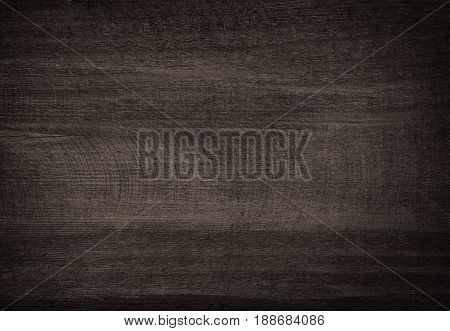 Black scratched wooden cutting board. Wood texture.
