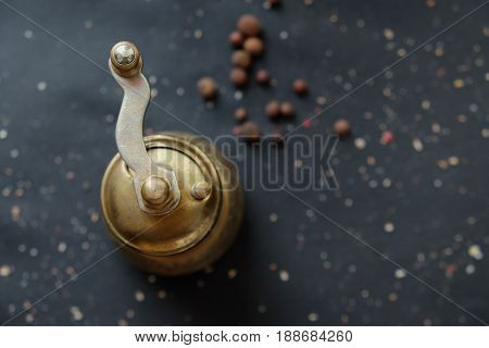 Hand-held coffee grinder on the table. Top view.