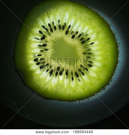 Cut kiwi fruit. Pulp and seeds of the fruit. Macro.