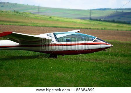 Trailed glider on the ground. Glider's cockpit.