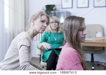 Worried mother looking for communication with her teenage daughter